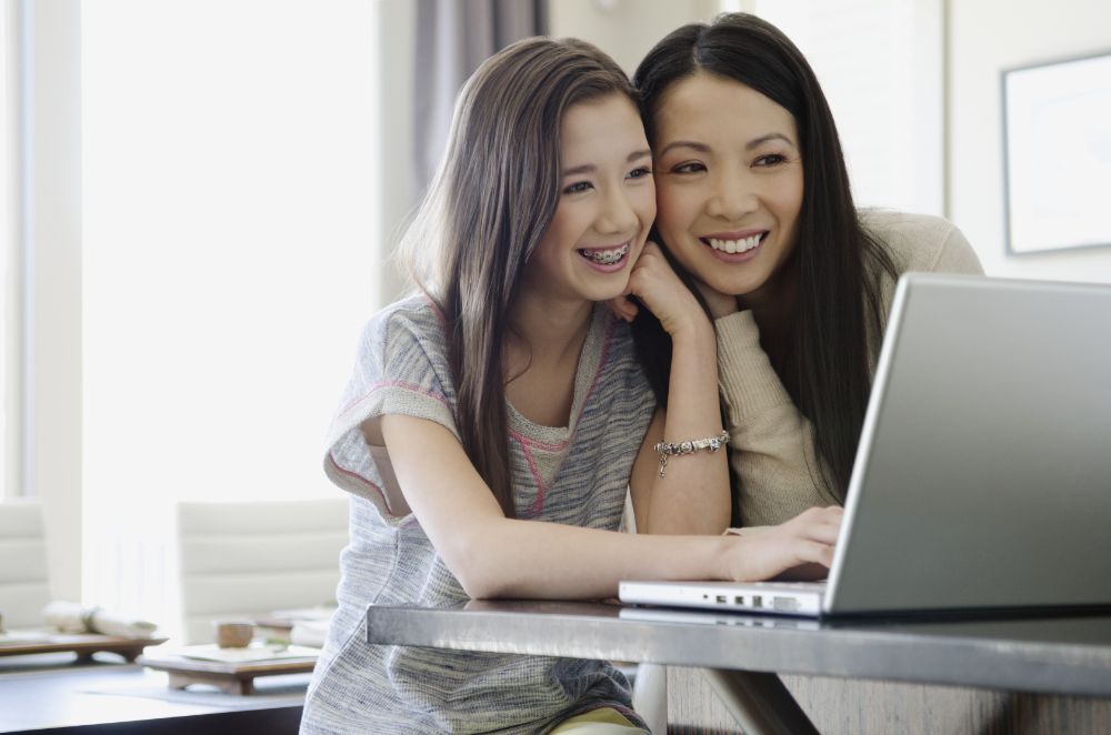 mom and daughter on laptop